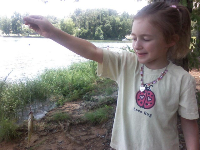 grand daughter chole with her first fish.